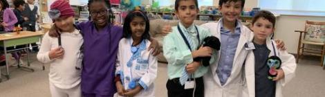 Interested in the medical field, second-graders Ely Fallet, Maya Peters, Serina Ninala, Josias Serrano, Jonathan Malin and A. J. Rivera, dress the part.
