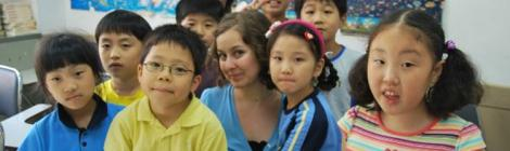 V. Michelle Bernard poses with her former students at the SDA Language Institute in South Korea.