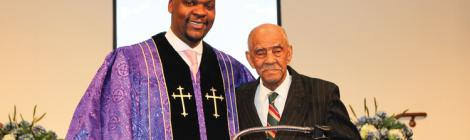 """Mackenzie Kambizi, pastor of the Ethan Temple church, celebrates member Benjamin """"Bennie"""" Grissom's 104th birthday and acknowledges his community work with the Jefferson Township Board of Trustees."""