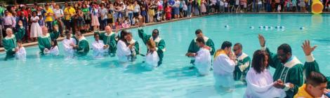 Sixty-four people, Hispanic and non-Hispanic, celebrate baptism during the Hispanic Camp Meeting