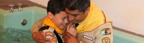 Pastor Marco Estrada baptizes a new member at Vineland Caravan of Compassion stop.