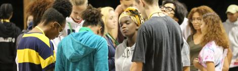 During opening night of SALT, students pray for each other's fears during an icebreaker activity.