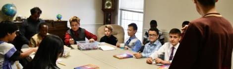 """Terri Saelee, North American Division coordinator for Adventist Refugee and Immigrant Ministries, shares a """"Loss Simulation' exercise with the Junior/Earliteen class."""