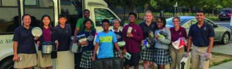 Matthew Abrams (center, in blue) and other Campus Ministries members prepare material to provide food for homeless people in Washington, D.C.