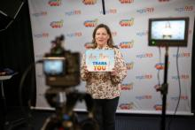 WGTS midday show host Becky Alignay records thank you videos for listeners who gave.