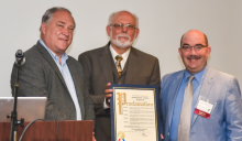 Montgomery County Council members Mark Elrich (left) and George Leventhal (right) present a proclamation of congratulations for ACSGW's 35 years of service to Ken Flemmer, executive director.