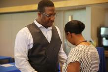 Marleena Debrough, pastor of the Prentis (Pa.) Park church, anoints and prays for Kevin Jenkins, a CAMCON attendee and member of the Southwest church in Philadelphia.