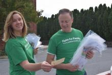 Michelle Becker, Allentown church member, and Gary Gibbs, conference president, prepare to go door to door in the community to pray with people and offer Bible studies, as part of the Faith for Family initiative.