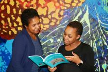 Math teacher D'Anya Brezzell (right) shares her thoughts about Kelli Raí Collins' new devotional book.