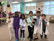 Interested in the medical field, second-graders Ely Fallet, Maya Peters, Serina Ninala, Josias Serrano, Jonathan Malin and A. J. Rivera, dress the part.