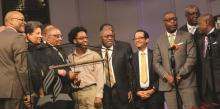 Lawrance E. Martin (pictured, third from left), Allegheny East Conference vice president for finance, accepts an Achievement Award at the Pastoral Evangelism and Leadership Conference.