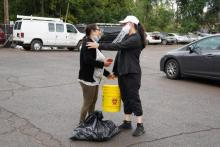 A New Jersey Conference volunteer greets one of the Hurrican Ida survivors.