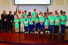 Education Superintendent Rick Bianco (far left) stands with the Geography Challenge emcee, winners, spon- sors and judges.