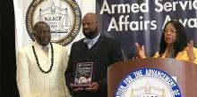 Richard Matthews (center) receives a NAACP award.
