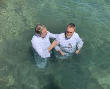 Jerry Lutz, executive secretary for the Chesapeake Conference, baptizes a seminar attendee during a mission trip to Roatan, Honduras.