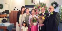 Ronald Cho and his family, along with Henry J. Fordham III, AEC president, celebrate 30 years of service.