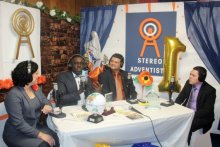 Peter Simpson (second from left) and a few of the radio team members celebrate their first anniversary.
