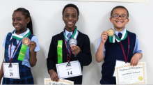 Science Fair primary winners llide Iheme, third place (BJA); Daniel Lightbody, second place (W. F. Mays); and Lawrence Talbert, first place (Dupont) display their medals.