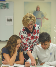 Shenandoah Valley Academy teacher Gabrielle Geddis Griffin instructs two of her students.