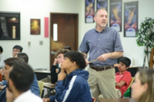 Alumnus Duane White ('86), now a physician, presents at Career Day.