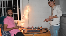 Hartle Hall residents Kevin Oliveira and Gabriel Moraes hang out together in the dorm.