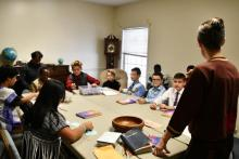 "Terri Saelee, North American Division coordinator for Adventist Refugee and Immigrant Ministries, shares a ""Loss Simulation' exercise with the Junior/Earliteen class."