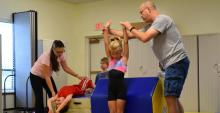 """Steve and Teri Siegel, Tumblers Loving Christ coaches, instruct two """"Tater Tots"""" tumblers during a Sunday class at the Miamisburg church."""