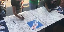 WGTS listeners sign a card for capitol police