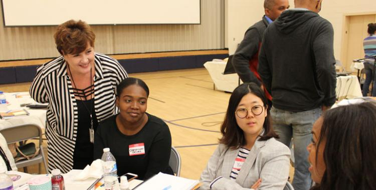 Lanelle Cobbin speaks with teachers from G.E. Peters at an Encounter curriculum training.
