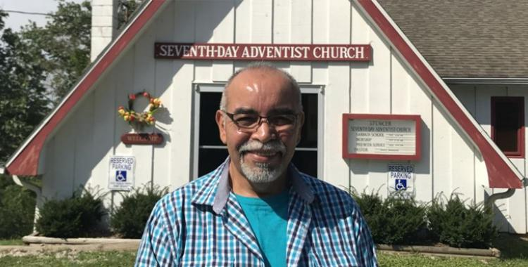 John Peña, 57, standing outside the Seventh-day Adventist church in Spencer, West Virginia. The church is among 35 that received Thirteenth Sabbath funds to organize evangelistic meetings in 2015. (Andrew McChesney / Adventist Mission)