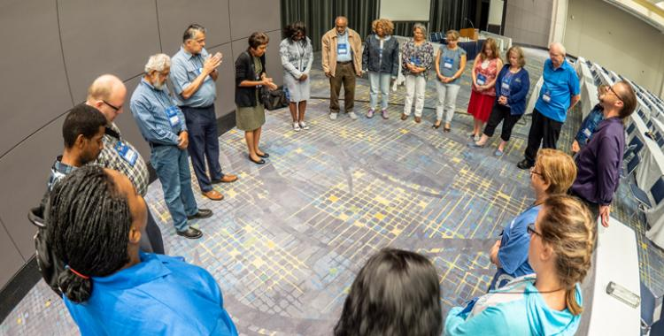 Teachers gather for a special time of prayer during the NAD Teachers Convention. Photo by NAD Communication