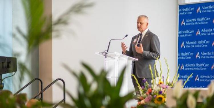 Erik Wangsness, president of WAH, speaks at the dedication of the new Adventist HealthCare White Oak Medical Center. Photo by Eli Turner