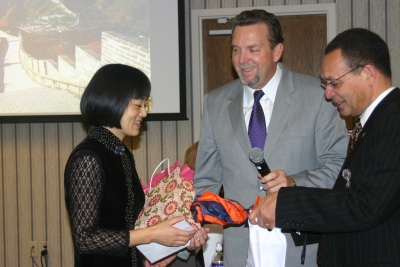Rebekah Liu accepts tokens of appreciation from Dave Weigley, Columbia Union president, and Weymouth Spence, president of Washington Adventist University in Takoma Park, Md.