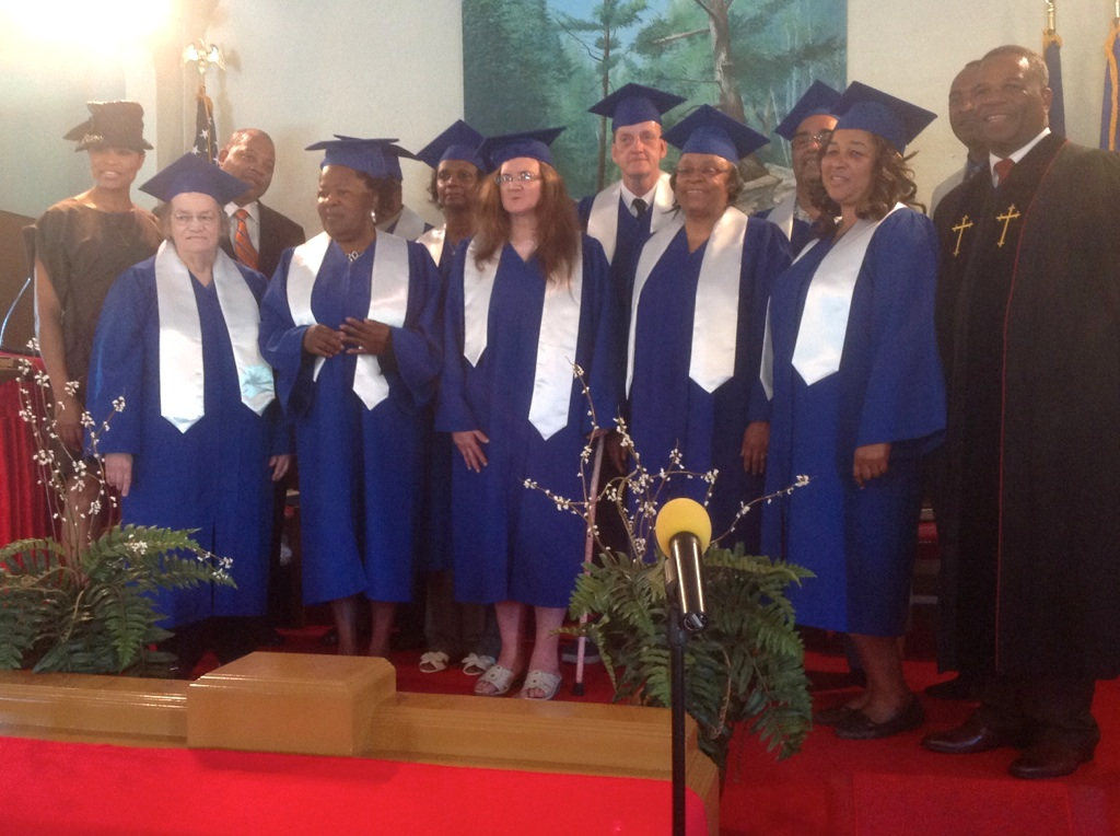 Class instructors and conference leaders celebrate with the graduates.